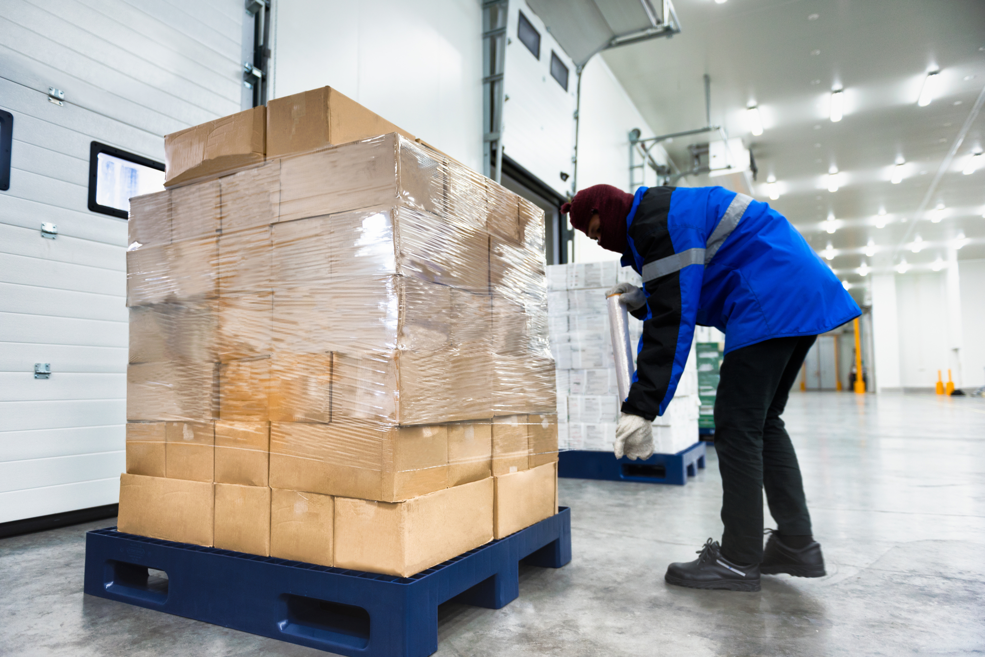 Plastic wrapper roll to packaging in loading goods of the freezing warehouse. Storage for Ready-made foods or Ready-to-Eat Foods. Export-Import Logistics system concept.
